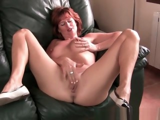 Redheaded mature mama plays with her nipples and pussy mature straight