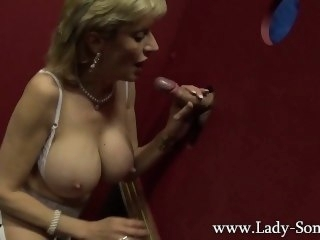 Blonde milf Lady Sonia sucking big dick on the glory hole blonde big tits