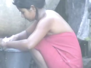 wow... eminent desi neighbourhood pub gal bathing outside straight indian