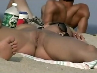 Lengthy voyeur movie of numerous amateurs about the nudis brunette beach